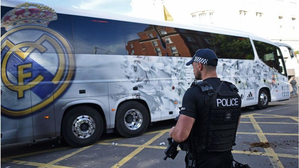 Policeman watches arrival of Real Madrid team bus in Cardiff in 2017
