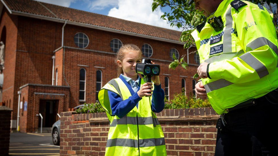 School girl using a speed camera