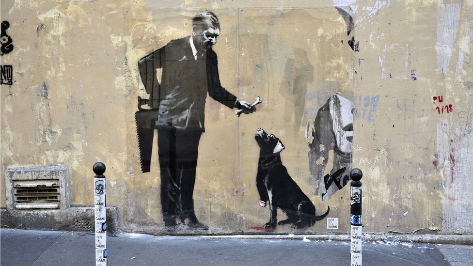 A recent artwork believed to be attributed to Banksy is of a man offering a dog a bone having first sawn the animal's leg off in the Sorbonne neighbourhood