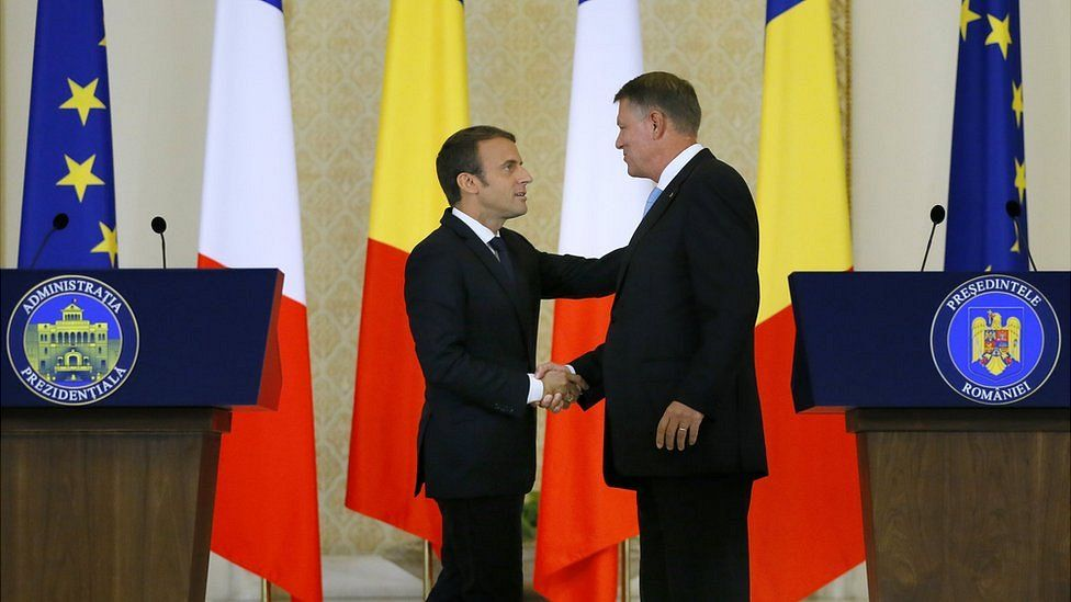 French President Emmanuel Macron (L) and his Romanian counterpart Klaus Iohannis (R), shake hands after their joint news conference at the Cotroceni Palace, in Bucharest, Romania, 24 August 2017.