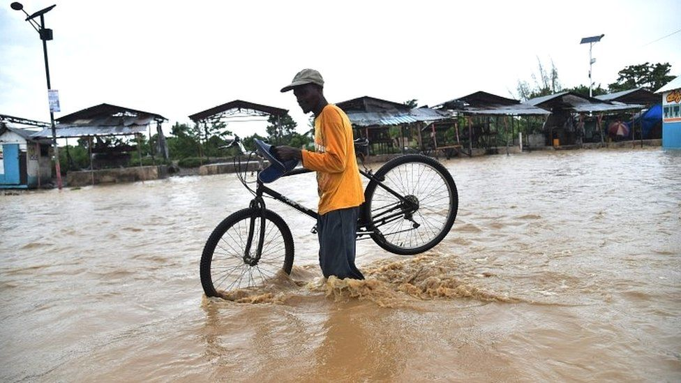 Crossing a flooded river near Port-au-Prince, Haiti, on 5 October 2016
