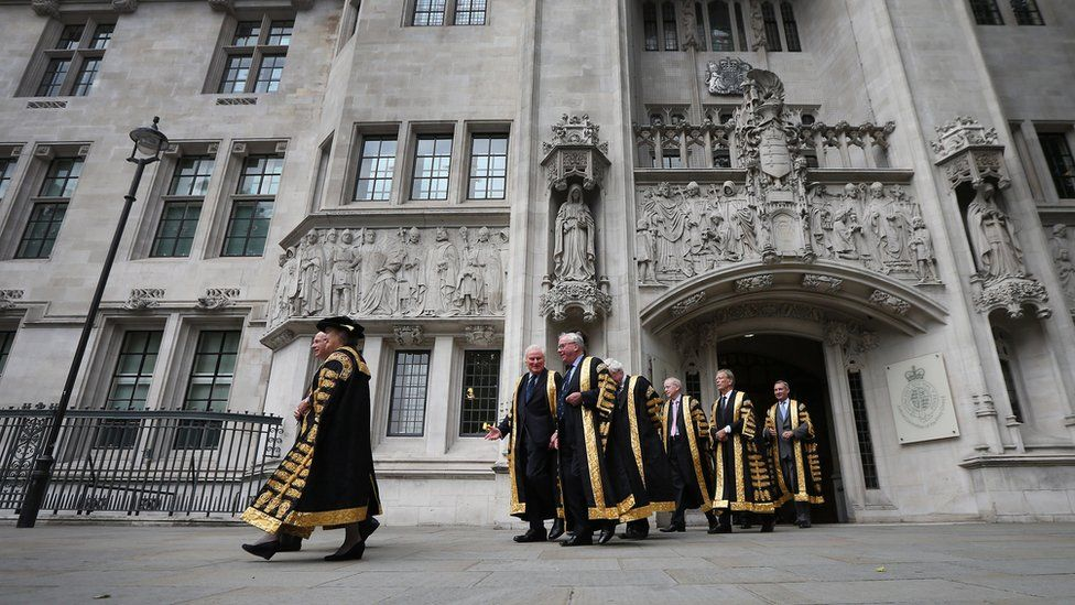 Supreme Court Justices process from the Supreme Court to Westminster Abbey on 1 October, 2013 in London