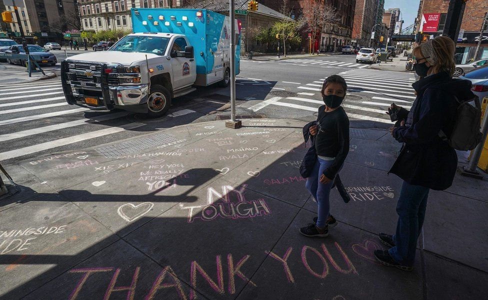 Thank you messages are written on the sidewalk outside of Mt. Sinai West Medical Center