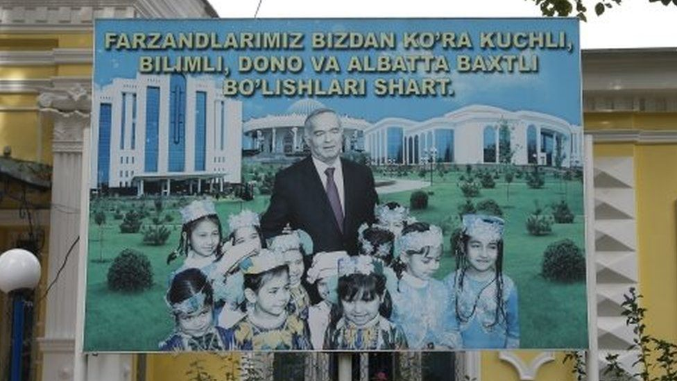 """A huge poster shows Uzbek President Islam Karimov posing with a group of children and the words reading """"Our children ought to be stronger and smarter than us and they ought to be happy!"""" (29 August 2016)"""