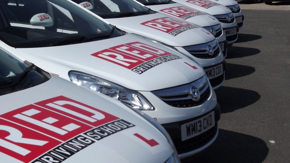 Red Driving School branded cars