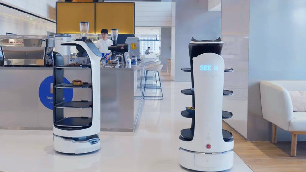 Two BellaBot robots in a restaurant