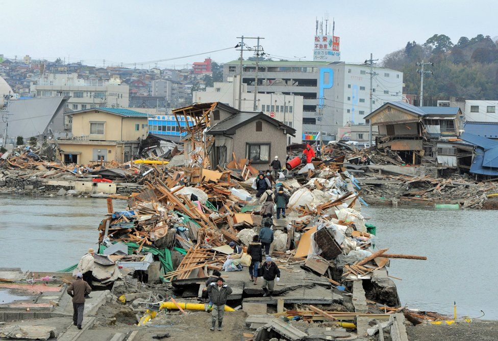 A bridge in Ishinomaki is covered in debris (Getty Images)