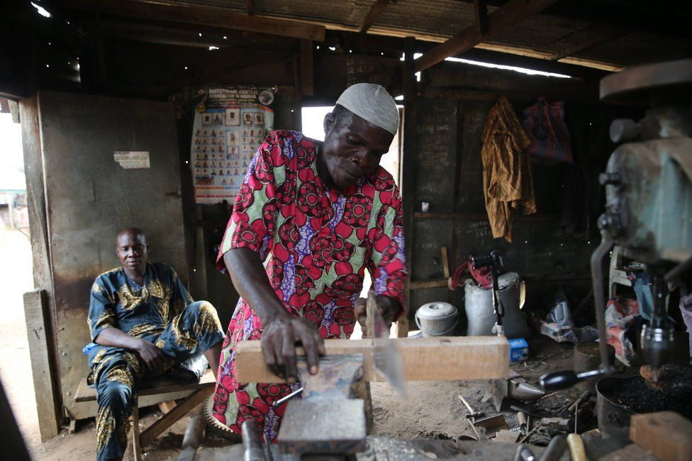 A blacksmith at work.
