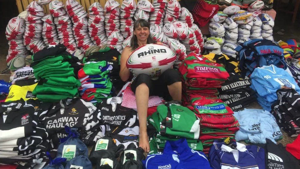 Mary Watkins in a pile of rugby kit