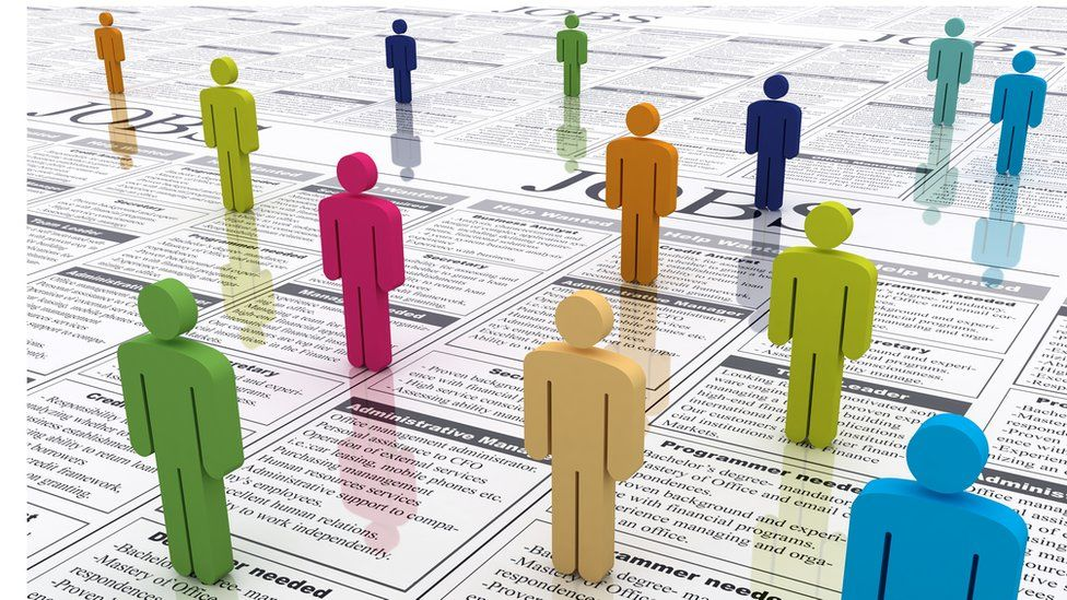 Colourful figures standing on newspaper job adverts