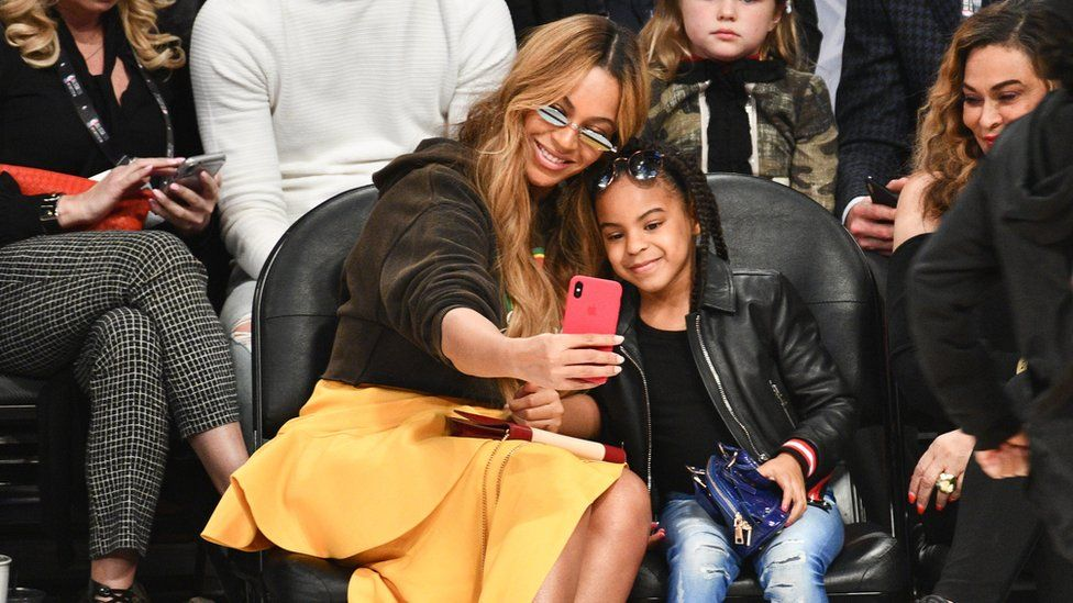 Blue Ivy and Beyonce at the 66th NBA All-Star Game in New Orleans, Louisiana.