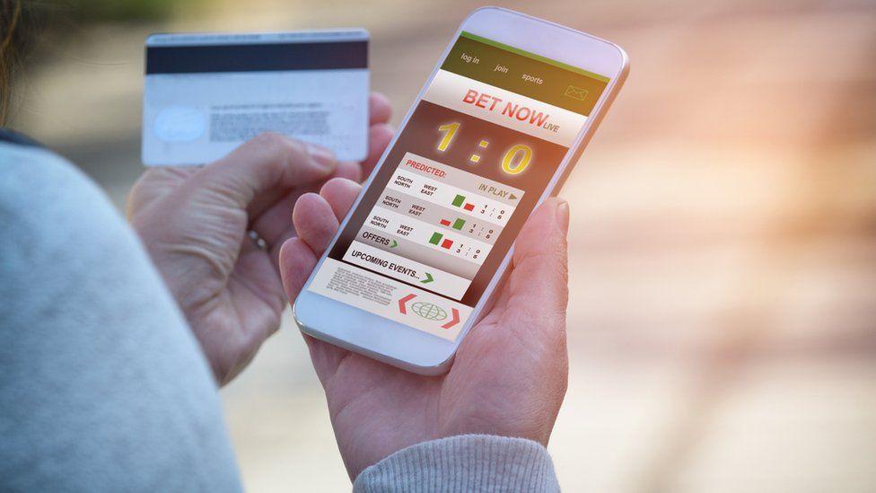 Man gambling on mobile phone