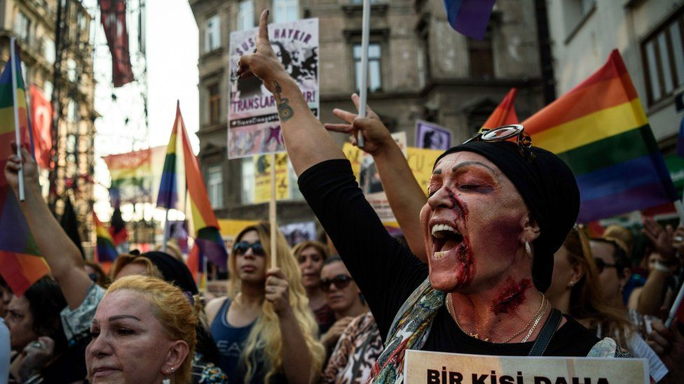 A LGBT member with make up on her face shouts slogans and gestures on August 21,2016 in Istanbul during a demonstration for the murdering of transgender activist Hande Kader