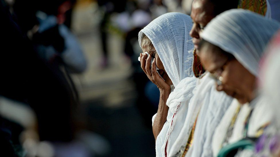 Eritrean people attend the commemoration ceremony for the victims of the boat sinking disaster off the Lampedusa coast on October 21, 2013 in San Leone near Agrigento, Italy