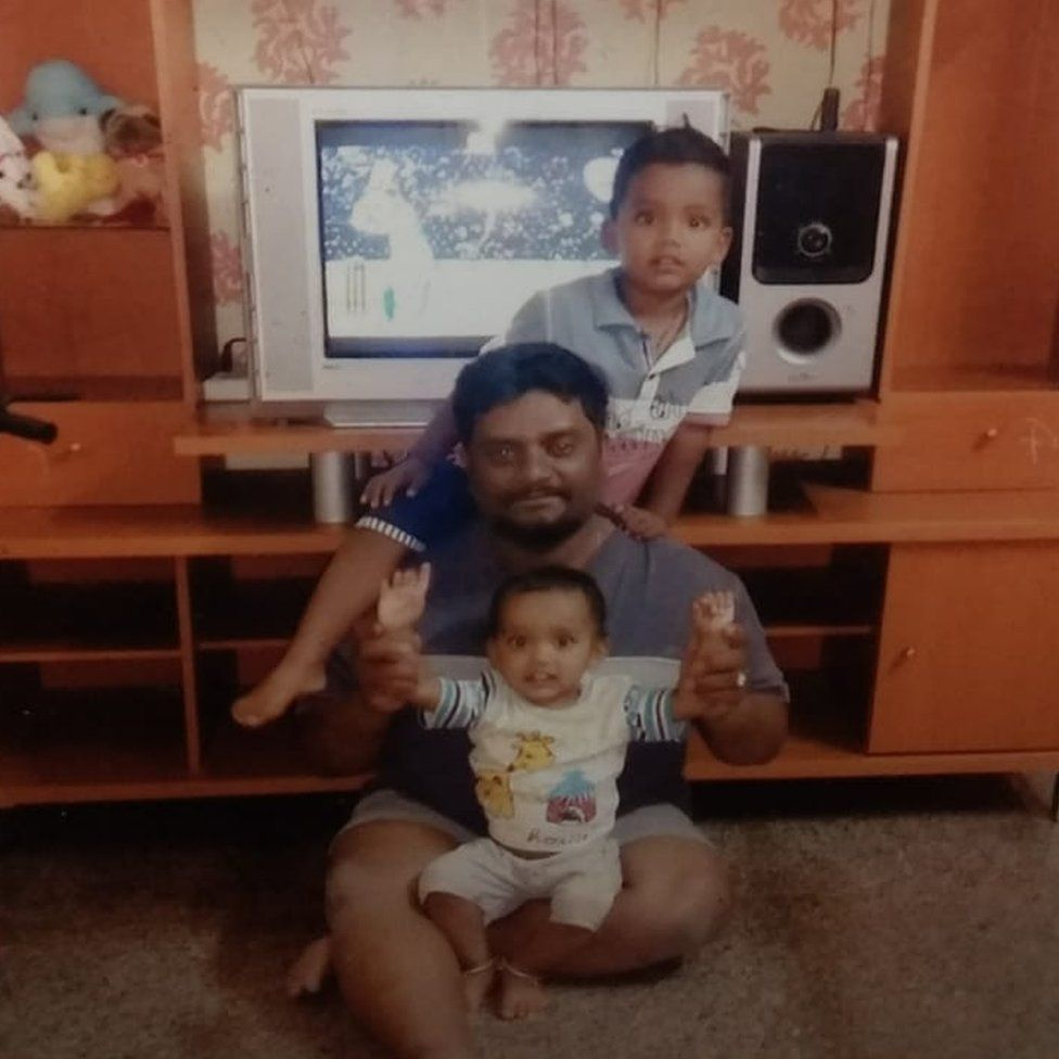 Rajesh with his two sons at home in Bangalore