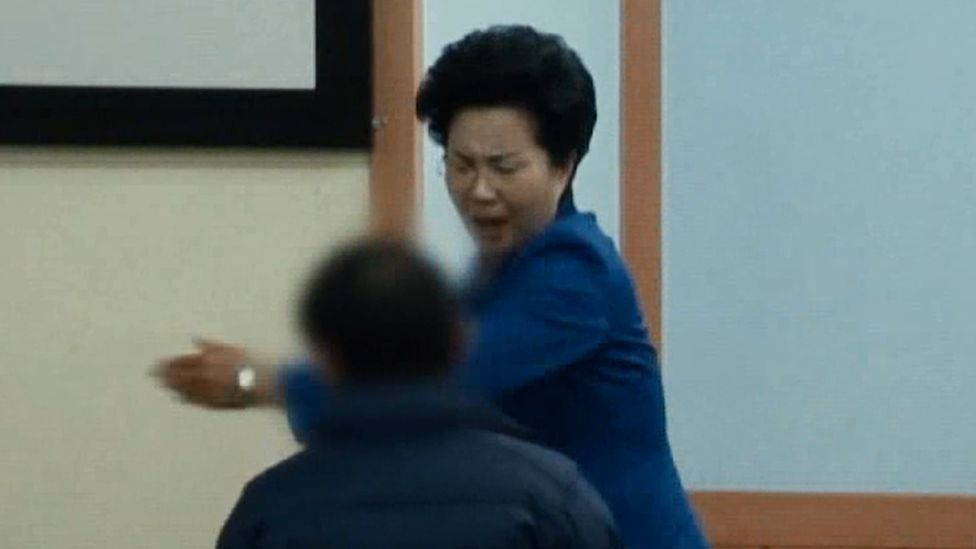A screenshot from an SBS documentary shows Ms Shin slapping one of her congregants