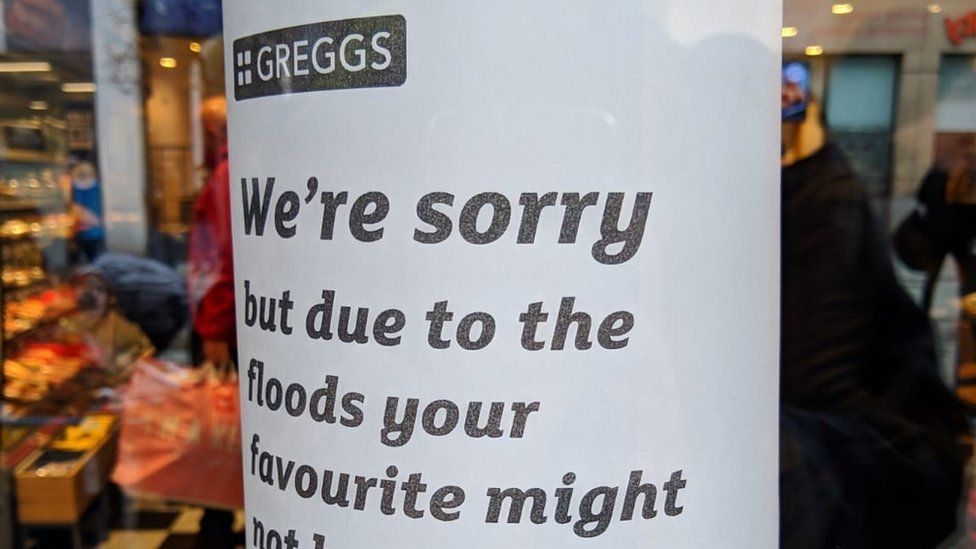 A poster in a branch of Greggs warning customers of product shortages due to flooding