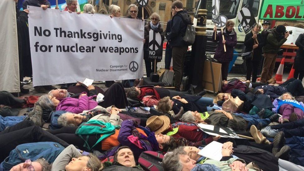 Protesters staging a 'die-in'