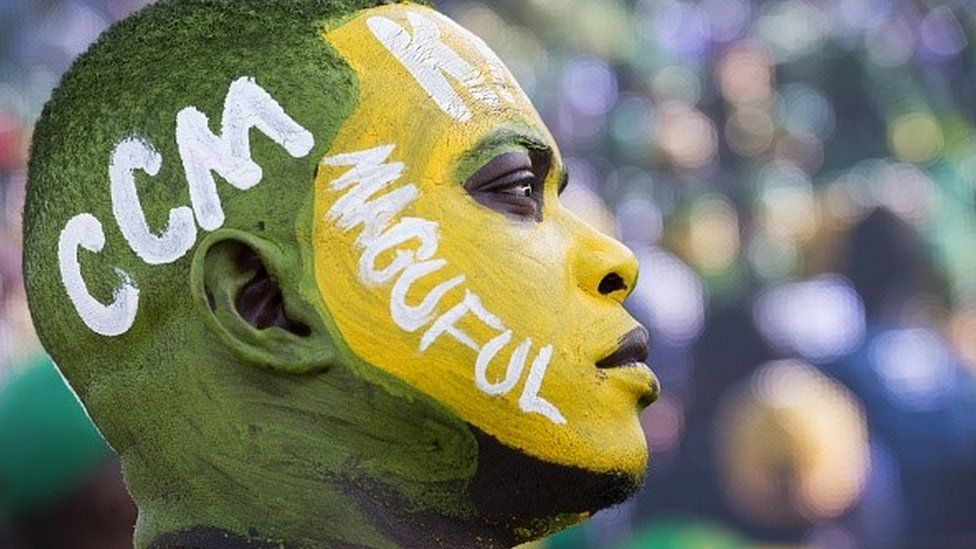 A supporter who painted his face with the party colours, attends the rally of the ruling party Chama Cha Mapinduzi (CCM) in Dar es Salaam, in Tanzania, on 23 October 2015