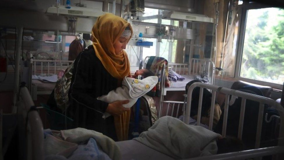 rescued mother and her newborn baby receive medical care in a hospital a day after the complex attack at MSF (Doctors without Borders) hospital, in Kabul, Afghanistan,
