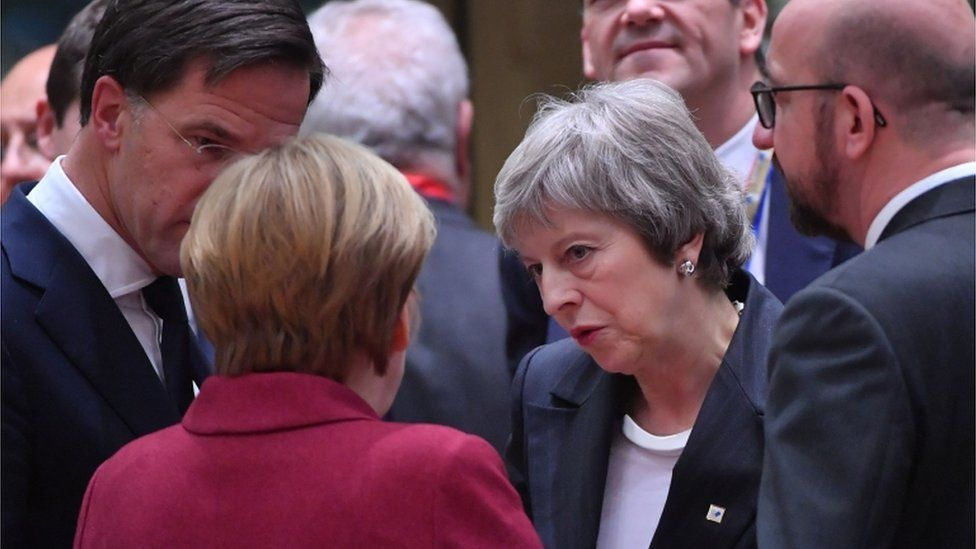 Theresa May talks with EU leaders at the summit