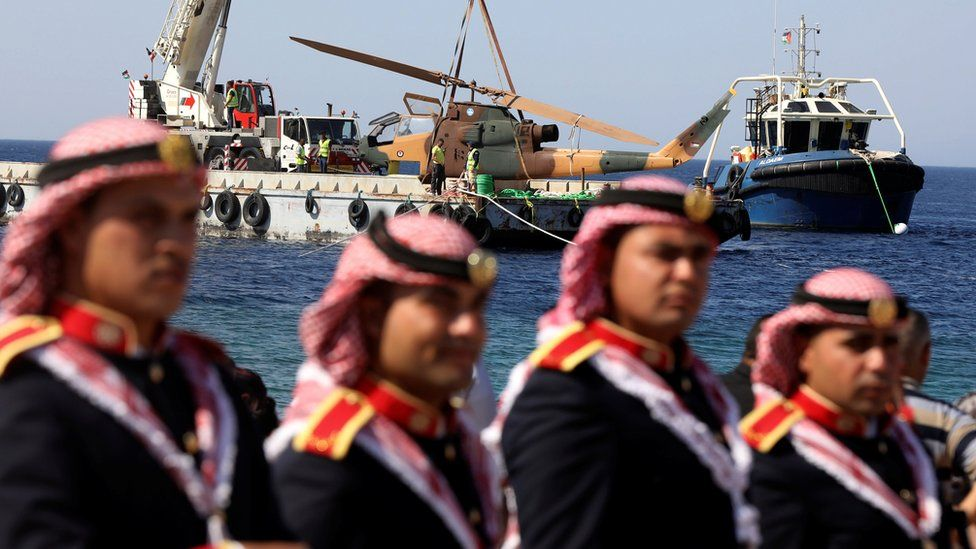 A body of a military helicopter, donated by the Jordanian Royal Air Force, is prepared to be submerged in the Red Sea off Aqaba