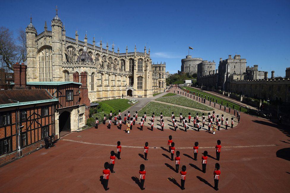 Members of the military stands outside St George's Chapel before the funeral service of Britain's Prince Philip, Duke of Edinburgh in Windsor Castle