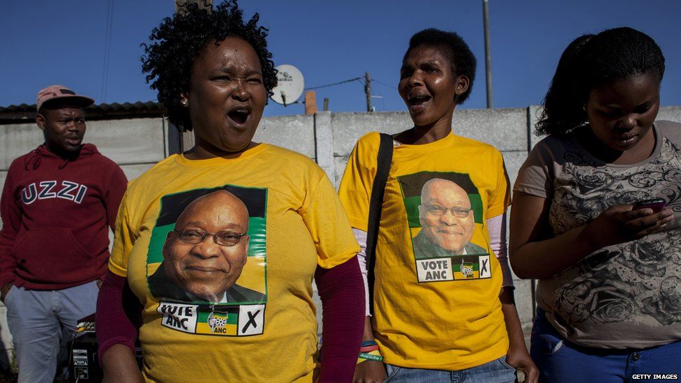 ANC supporters cheer on voters along the streets of Khayelitsha Township on May 7, 2014 in Cape Town, South Africa.