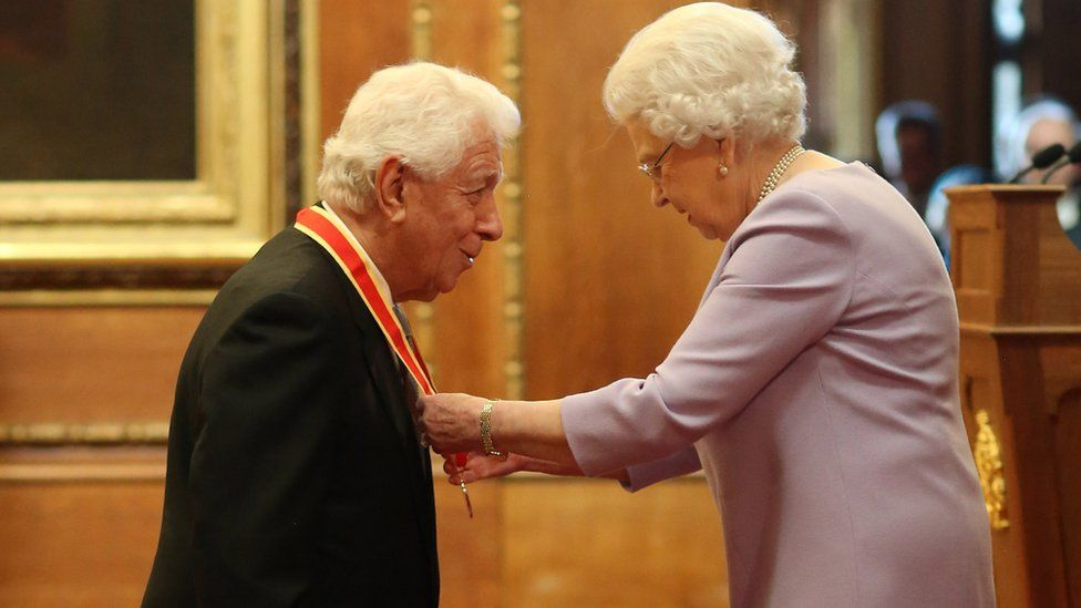 Sir Frank Lowry with the Queen at Windsor Castle investiture in December 2017