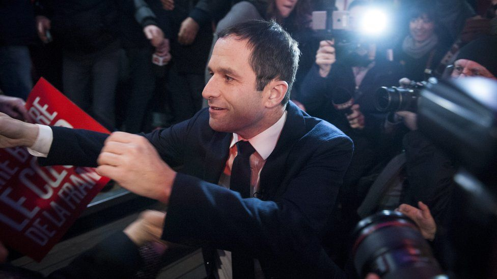 French former Education minister Benoit Hamon (C) arrives for a speech after the results of the first round of the party primaries in Paris, France, 22 January 2017