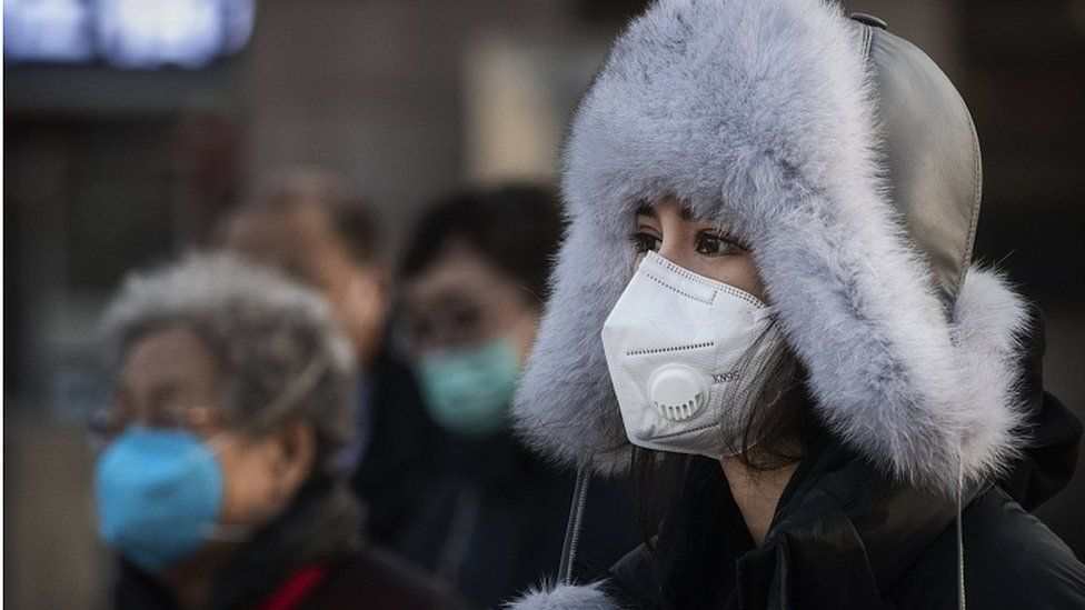 A woman wears a protective mask after getting off a train on January 31, 2020 in Beijing, China