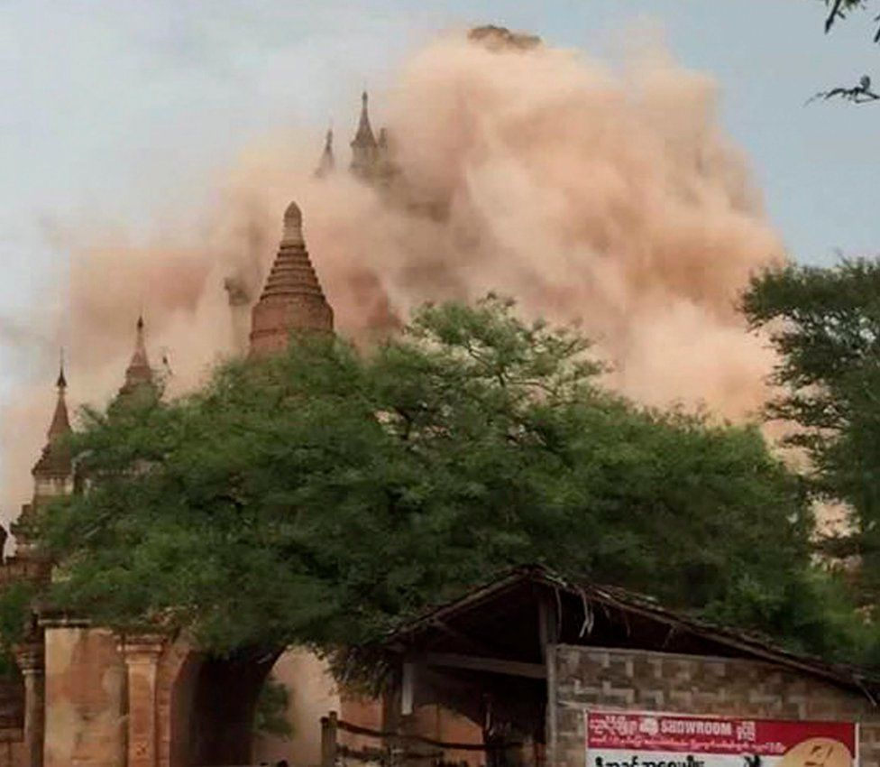 24 August 2016 photo showing a huge cloud of dust coming from a temple during the earthquake.