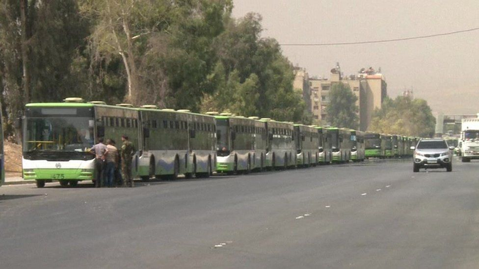 Buses lined up before entering Darayya.