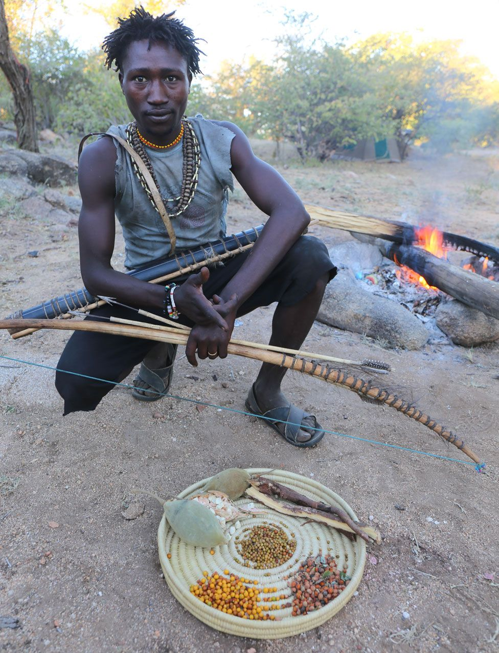 Hadza man with assorted nuts and berries