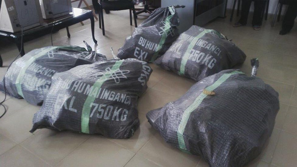Five black bags supposedly containing the seized cash