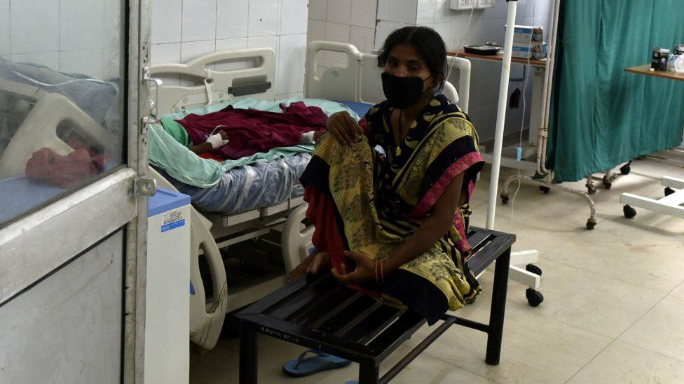A woman attends to her relative inside the Covid-19 ward, at Ram Manohar Lohia Hospital, in Gomti Nagar, on September, 2020 in Lucknow, India