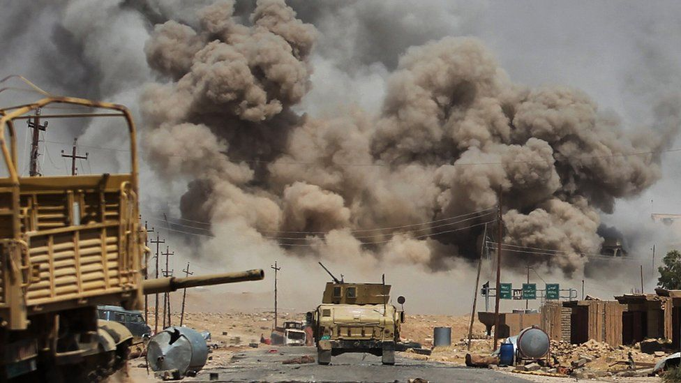 Smoke billows as Iraqi forces advance towards Ayadiya, so-called Islamic State's last remaining active front line near Tal Afar, 29 August 2017