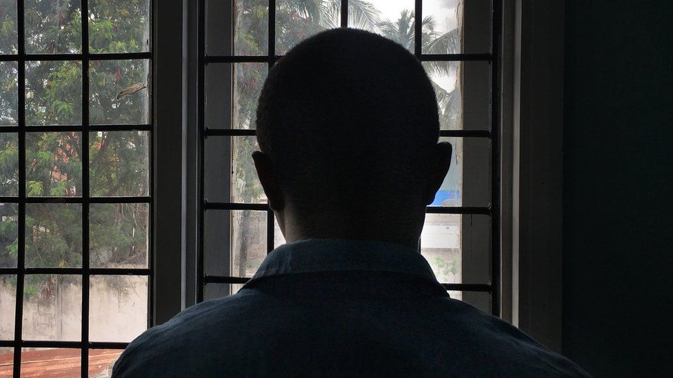 A gay man with HIV stands in a clinic in Dar es Salaam, Tanzania, 2016