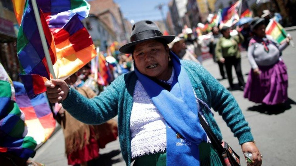 Supporters of Bolivian President Evo Morales march in La Paz, Bolivia on 23 October