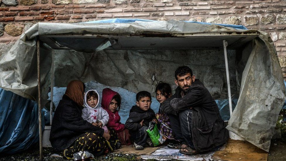 A Syrian family shelters in a tent in Turkey