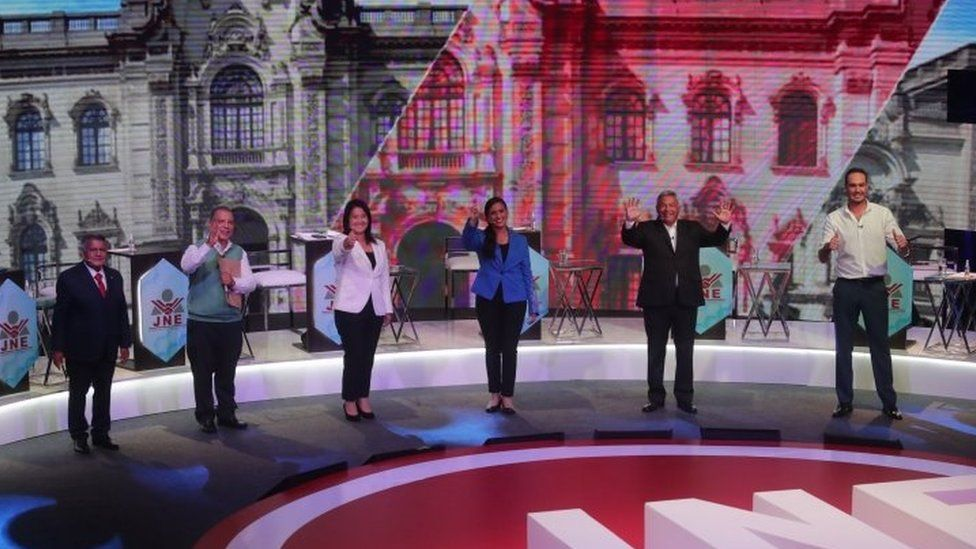 Presidential candidates (L-R) Alberto Beingolea, Marco Arana, Keiko Fujimori, Veronika Mendoza, Cesar Acuna and George Forsyth greet during the first day of the three debates organized by the National Elections Jury in Lima, Peru, 29 March 2021.