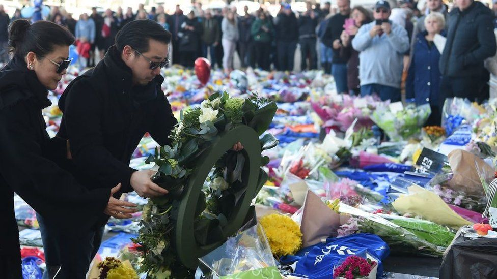 Aiyawatt Srivaddhanaprabha and the club owner's wife Aimon Srivaddhanaprabha lay a wreath at the tributes to the victims of the crash at Leicester City Football Club's King Power Stadium