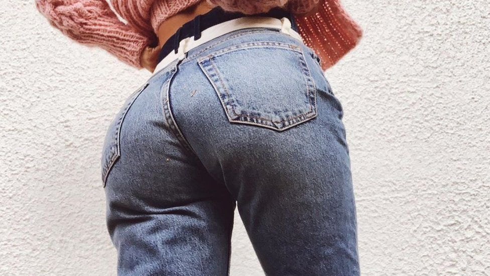 A picture of Sophie Elise wearing jeans
