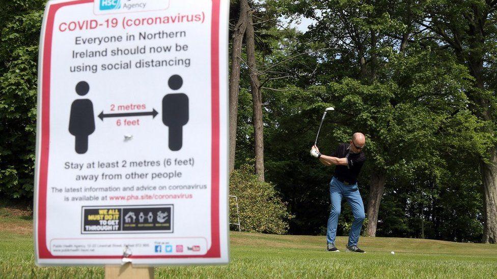 A golfer tees off at Masserene Golf Club in Antrim