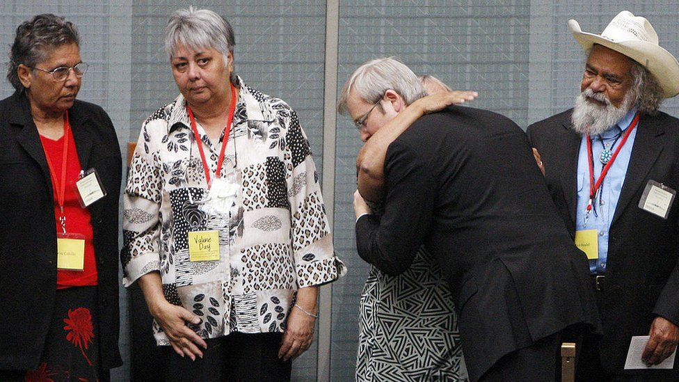 Kevin Rudd hugs members of the Stolen Generations after his apology speech in 2008
