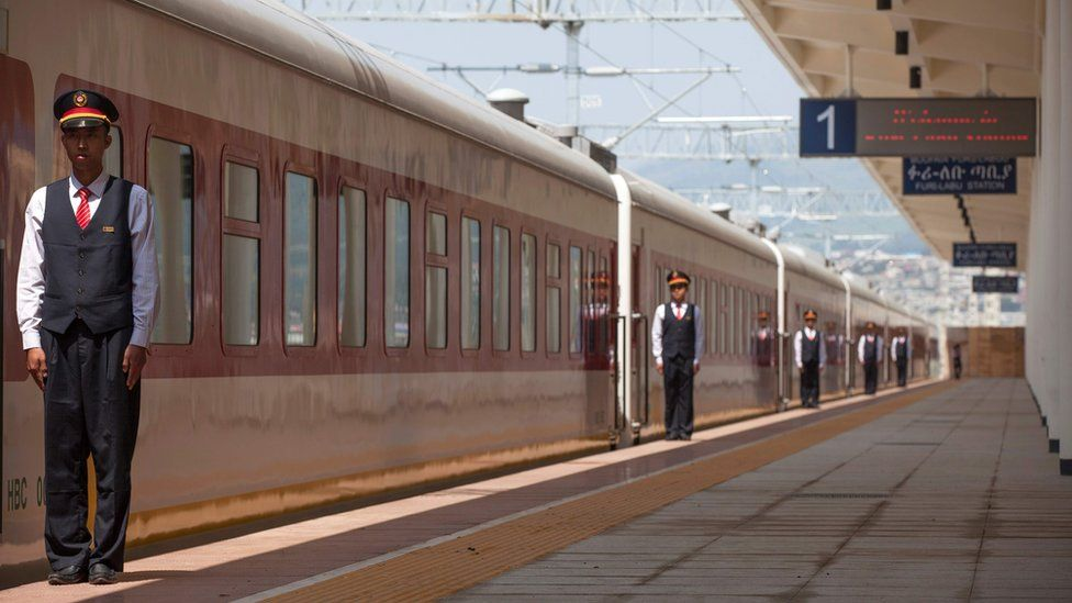 Chinese employees of the Addis Ababa / Djibouti train line stand at the Feri train station in Addis Ababa on September 24, 2016. With Chinese conductors at the helm, a fleet of shiny new trains will on October 5, 2016 begin plying a new route from the Ethiopian capital to Djibouti, in a major boost to both economies.