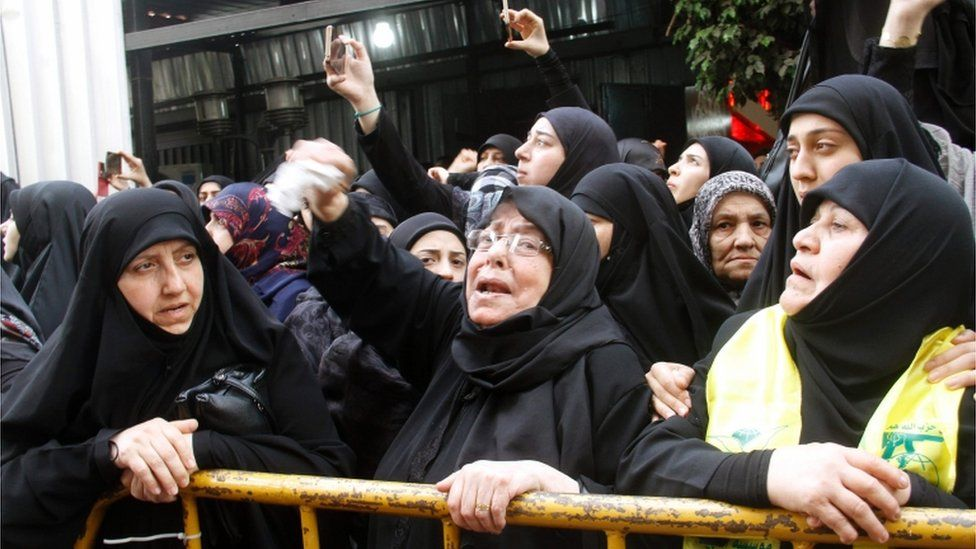 "Lebanese women, supporting Lebanon""s Shiite militant group Hezbollah, mourn during the funeral of Mustafa Badreddine"