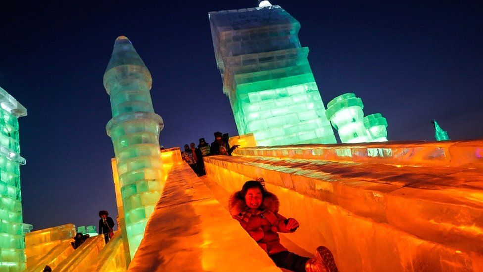 A child rides a slide of an ice sculpture of the Ice and Snow World during the annual Harbin International Ice and Snow Sculpture Festival, in Harbin, China, on 4 January 2019