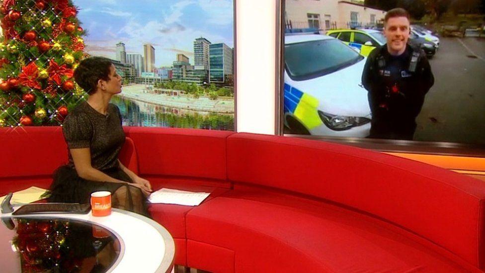 PC Jamie Aston in Bangor and the BBC's Naga Munchetty in the studio