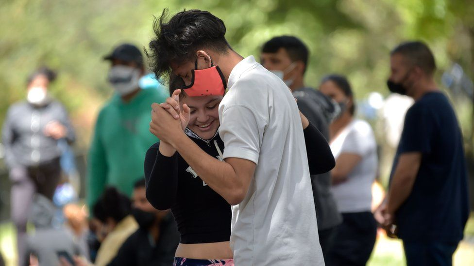 Venezuelan migrants dance at an improvised camp in Bogota on June 9, 2020.